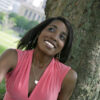 Lady with relaxed hair smiling