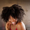 Woman with big natural hair laughing