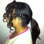 Side braid detail ponytail with curly leave out at the front