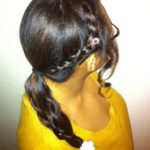 Side braid detail with white flower clip on ponytail