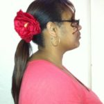 Ponytail accessorized with red flower clip