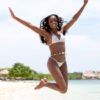 African American woman in bikini at the beach