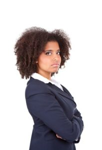 Woman with curly hair looking serious and angry