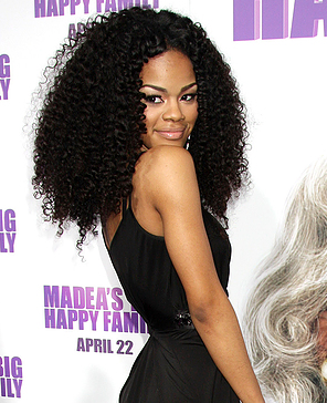 Teyana Taylor with long kinky curly hair
