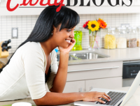 African american woman using computer smiling