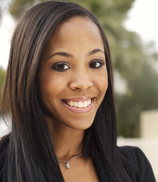 Pretty woman with relaxed hair smiling
