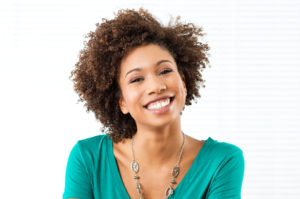Woman with kinky curly 4a hair smiling