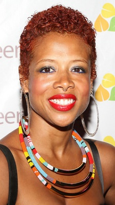 Kelis with Teeny Weeny Afro TWA and bright red lipstick