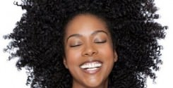 African american woman with natural hair smiling with eyes closed