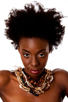 Woman with kinky natural hair and heavy ethnic necklace