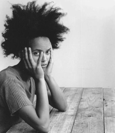 Black woman with natural hair having a bad hair day