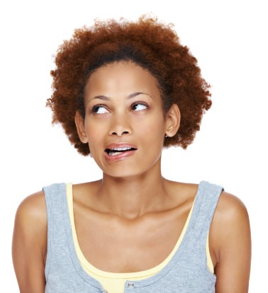 African American woman with natural hair looking confused