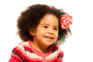 Close portrait of little mixed race girl