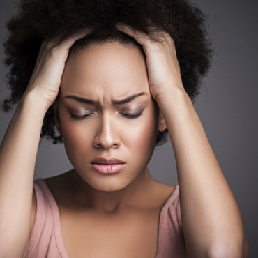 Frustrated woman with natural hair