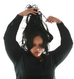 Woman cutting her relaxed hair off