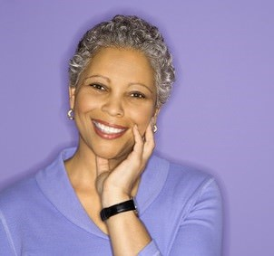 African American woman with greying natural hair