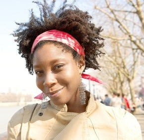 African American woman with natural hair and headband smiling