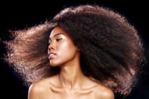Black woman with long flowing kinky natural hair