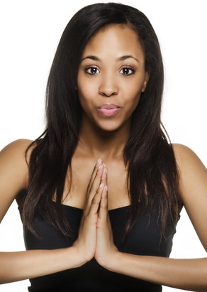 Young African American woman in a praying stance