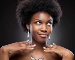 African American woman with natual kinky hair smirking