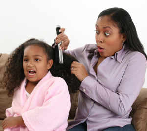 mother-brushing-daughters-hair