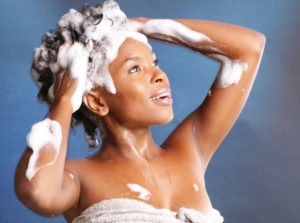 Black woman shampooing her hair