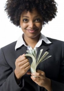 African american woman with natural hair holding money