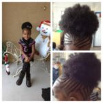 Cornrows with an afro puff ponytail. Lovely!