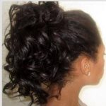 Curly ponytail created using bantu knots