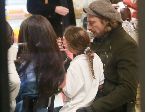 Gabriel Aubry plays with daughter Nahla's hair