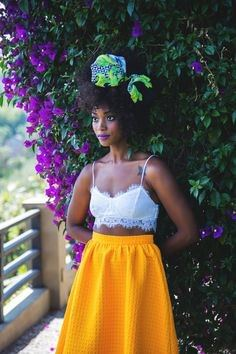 Woman standing near a bush