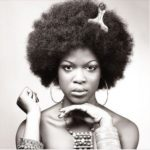 Woman with afro pick