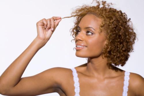 Smiling woman pulling hair
