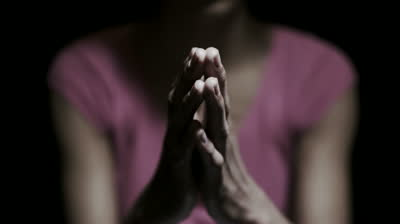 Woman with praying hands