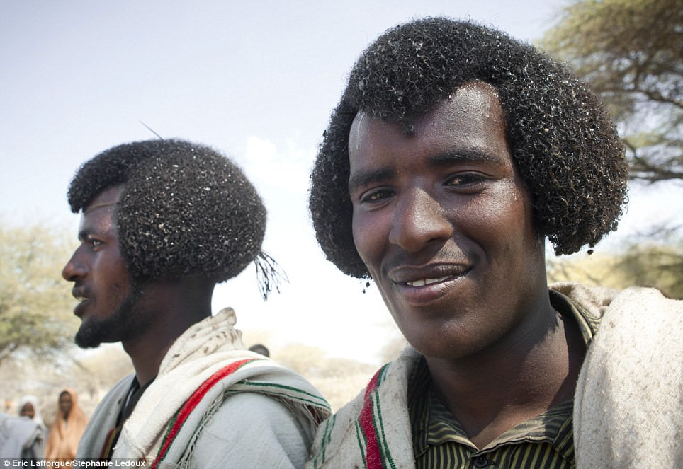 Karrayyu tribe cover their beautifully  cut afro hairstyles, known as gunfura, with butter