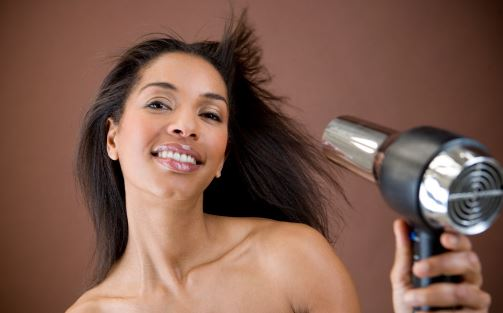 woman with a hair dryer