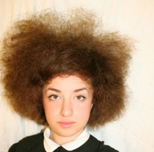 white woman with afro hair