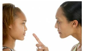 black mom scolding her daughter