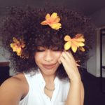 Would You Rock It? The 'Floral Fro' Is A Trend That's Here To Stay