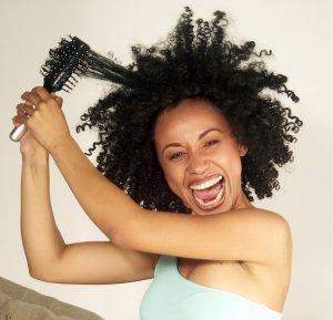 afro-american-woman-detangling-hair-2